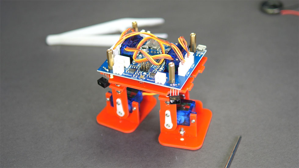 Controller board on top of face place and assembled legs.
